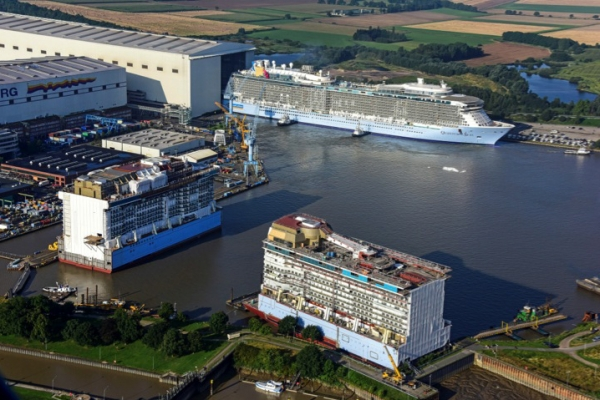 The Anthem of the Seas floats in 2 parts while the Quantum of the Seas is floated out.