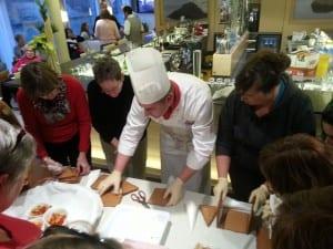 Chef Zoran teaching cruisers how to make gingerbread houses.