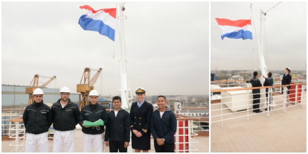 Dutch flag being raised on the ship for the first time.